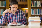 Mature student studying at desk in the library — Stock Photo