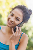 Portrait of amused young woman phoning — Stock Photo