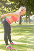 Active serious blonde stretching her body — Stock Photo