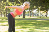 Active focused blonde stretching her body — Stock Photo
