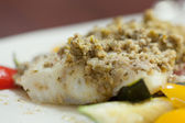 Close up of delicious fish dish with pesto — Stock Photo