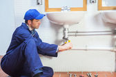 Attractive concentrating plumber repairing sink — Stock Photo