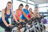 Five people working out at spinning class — Stok fotoğraf