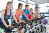 Five people working out at spinning class — Photo
