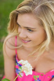 High angle view of content young woman holding a white flower — Stock Photo