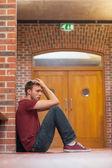 Unhappy handsome student having a headache — Stock Photo