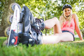 Casual attractive blonde wearing roller blades and helmet — Stock Photo