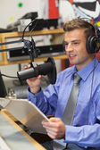 Well dressed happy radio host moderating — Stock Photo