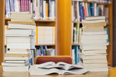 Stacks of books on desk — Stock Photo