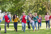 College students running in the park — Stockfoto