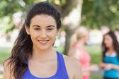 Beautiful sporty woman posing in a park — Stok fotoğraf