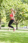 Side view of sporty woman skipping — Stock Photo
