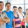 Portrait of a group of fitness class standing in row — Stock Photo
