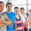 Portrait of a group of fitness class standing in row — Stock Photo #36242487