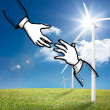 Two hands graphic on bright countryside with wind turbines  — Foto Stock
