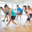 Fitness class and instructor doing power fitness exercise — Stock Photo