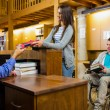 Stock Photo: Students with handicapped mat library counter