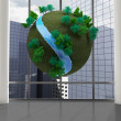 Earth floating in front of cityscape — Stock Photo