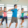 Sporty people doing power fitness exercise at yoga class — Stock Photo #36244011