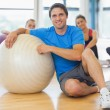 Instructor and fitness class with exercise balls at gym — Stock Photo