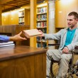 Stock Photo: Student in wheelchair at library counter