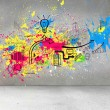 Colorful splashes on grey wall with graphics — Stock Photo #36244649