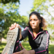 Pretty sporty woman stretching her leg in park — Stock Photo #36245037
