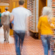Blurred students walking through corridor — Stock Photo #36245801