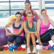 Group of fitness class at a bright exercise room — Stock Photo