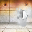 Open safe in dust cloud in grey room — Stock Photo