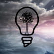 Light bulb with tree over sky — Stock Photo