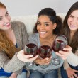 Cheerful young female friends toasting wine glasses — Stock Photo