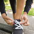 Close up low section of sporty womwearing shoes in park — Stock Photo #36247843