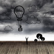 Hot air balloon at wall with stormy sky — Stock Photo