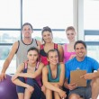 Portrait of an instructor with fitness class — Stock Photo