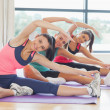 Fitness class and instructor doing stretching pilate exercises — Stock Photo #36249511