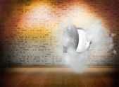 Open safe in dust cloud on brick lined wall — Stock Photo
