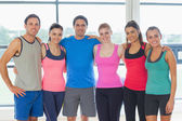 Portrait of a group of fitness class at exercise room — Stock Photo