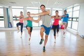 Full length of fitness class and instructor doing pilates exercise — Stock Photo