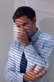 Elegant businessman with a cough against the wall — Stock Photo