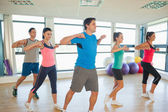 Sporty people doing power fitness exercise at yoga class — Stock Photo