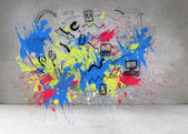 Colorful splashes on grey wall with graphics — Stock Photo