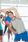 People doing power fitness exercise at yoga class — 图库照片