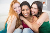 Portrait of happy female friends embracing each other — Stock Photo