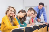 Teacher with college students in the classroom — Stock Photo
