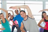 People doing power fitness exercise at yoga class — Stock Photo