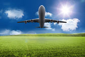 3D plane taking off over grassland — Stock Photo