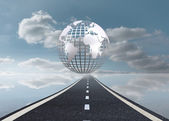 Digitally generated earth floating over street — Stock Photo