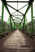 Footbridge with symmetrical metal structure — Stock Photo