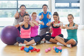 Full length portrait of fitness class gesturing thumbs up — Stok fotoğraf
